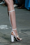 Knee high strapped heels at Alexander Wang