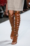 Strapped, knee-high peep-heel gladiators at Altuzarra