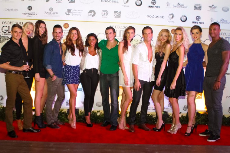 Event designer, Johanne Gardere ( black pants, and gold jacket in the middle) poses with her models.